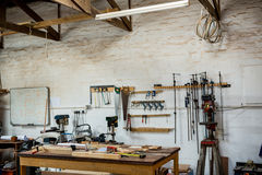 Tools and equipment used for carpentry. In a dusty workshop Royalty Free Stock Images