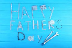 Tools for fathers day. Wrench tools for fathers day on blue wooden table stock photos