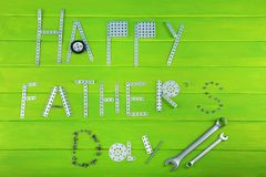 Tools for fathers day. Wrench tools for fathers day on green wooden table royalty free stock photography