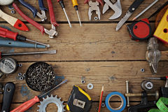 Tools on a floor, the top view. Tools are spread out on a timber floor round a blank space for your text, the top view Royalty Free Stock Photography