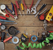 Tools on a floor, the top view. Tools are spread out on a timber floor round a blank space for your text, the top view Stock Photo