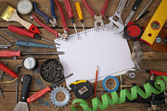 Tools on a floor, the top view. Tools are spread out on a timber floor round a blank space for your text, the top view Stock Photography