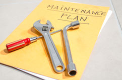 Tools on a folder of maintenance plan Stock Photography
