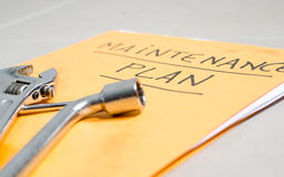 Tools on a folder of maintenance plan Royalty Free Stock Images