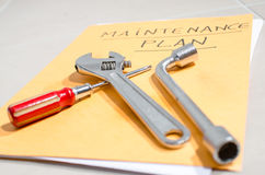 Tools on a folder of maintenance plan Stock Images