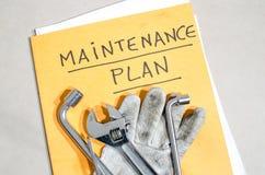 Tools on a folder of maintenance plan stock photos