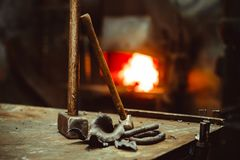 Tools in the forge. Hand anvil. hummers all blacksmith tools in forge stock photography