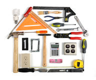 Tools in the Form of House. Tools forming a house with energy efficiency chimney Royalty Free Stock Photos