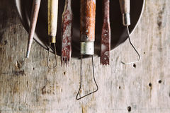 Tools for forming clay with pots on wood background Royalty Free Stock Photography