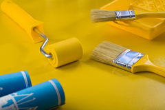 Tools fot painting on yellow table Stock Images