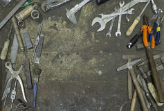 Tools in frame shape in workshop Royalty Free Stock Images