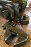Tools and gadgets against rust. Wrench, spanner and nut against rust and oil Stock Photo