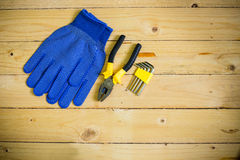Tools and gloves on wooden table Royalty Free Stock Photos