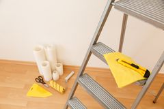 Tools for gluing wallpapers. Renovation Stock Image