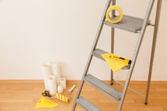 Tools for gluing wallpapers. Renovation Royalty Free Stock Photo