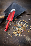 Tools of gold digger. And stones on a table royalty free stock photo
