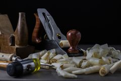 Old and new woodworking tools in a dark moody setting. stock images
