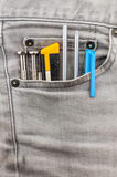 Tools in grey jean pocket Stock Photos