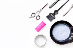Tools for hair dye and hairdye top view white background Stock Photo
