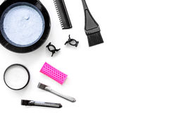 Tools for hair dye and hairdye top view white background Royalty Free Stock Photo