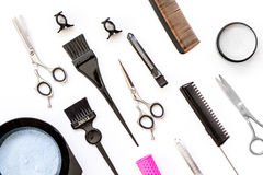 Tools for hair dye and hairdye top view white background Stock Photos