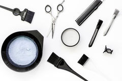 Tools for hair dye and hairdye top view white background Stock Photography