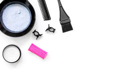 Tools for hair dye and hairdye top view white background Royalty Free Stock Photography