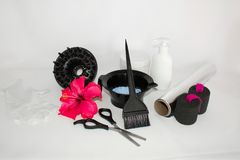 Tools for hair dye and hairdye white background.Barber set with hair dye, foil and brush, scissors and curlers. Set for coloring. Tools for hair dye and hairdye royalty free stock photography