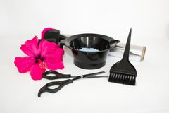 Tools for hair dye and hairdye white background.Barber set with hair dye, foil and brush, scissors and curlers. Set for coloring. Tools for hair dye and hairdye stock image