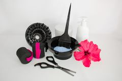 Tools for hair dye and hairdye white background.Barber set with hair dye, foil and brush, scissors and curlers. Set for coloring. Tools for hair dye and hairdye stock photo