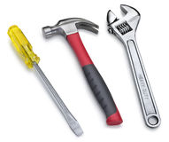 Tools Hammer Wrench Screwdriver. A new hammer, wrench and screwdriver on a white background Royalty Free Stock Images