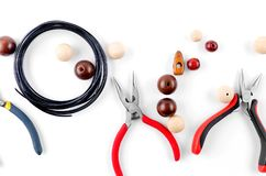 Tools for handmade jewelry. Beads, plier and wire. Tools for handmade jewelry. Beads, plier, memory wire and accessories to create hand made fashion jewelry Top royalty free stock images