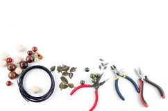 Tools for handmade jewelry. Beads, plier and wire. Tools for handmade jewelry. Beads, plier, memory wire and accessories to create hand made fashion jewelry Top stock photos