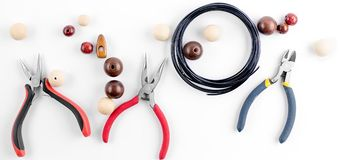 Tools for handmade jewelry. Beads, plier and wire. Tools for handmade jewelry. Beads, plier, memory wire and accessories to create hand made fashion jewelry Top stock photo