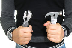Tools. In the hands of the man dressed in a black jacket Stock Image