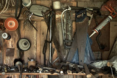 Tools hanging on a barn wall Royalty Free Stock Images