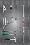 Tools Hanging on a  board Wall. Set of repair construction tools in the flat style equipment in a concept vector illustration Royalty Free Stock Photos