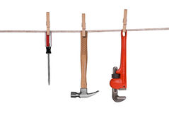 Tools hanging on a clothesline Royalty Free Stock Photo