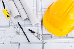 Tools with hardhat on blueprint. High angle view of tools with hardhat on blueprint Stock Photo