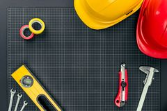 Tools and hardhats on graph paper Royalty Free Stock Photo