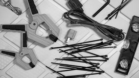 Tools and hardware objects, grayscale assorted work items. On industrial background stock photography