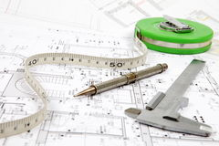 Tools for home renovation on architectural drawing Royalty Free Stock Images