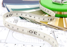 Tools for home renovation on architectural drawing Stock Photos