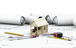 Tools and house rolls. Tools and wooden house on a rolls. Conceptual image. 3d Royalty Free Stock Images