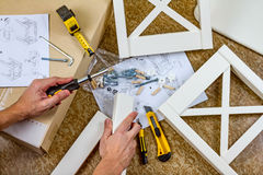 Tools, instructions and details for assembly furniture, man hands Royalty Free Stock Photos