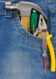 Tools and instruments. In blue jeans Stock Photos