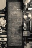 Tools and instruments on black table. Background, top view stock photo