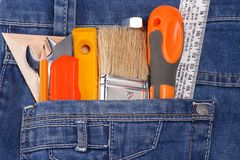 Tools and instruments on jeans Stock Image