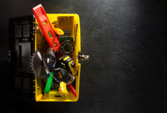 Tools and instruments in toolbox. Tools and instruments with toolbox  on black background Royalty Free Stock Photo