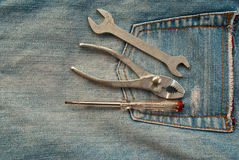 Tools on jean. Stock Images